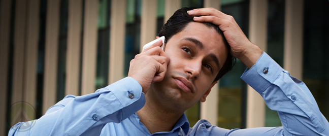 frustrated man on phone call hand over head
