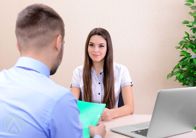 job applicant in interview with company boss