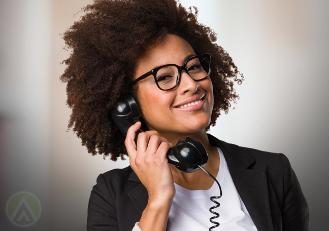 proud smiling business woman in glasses making phone call