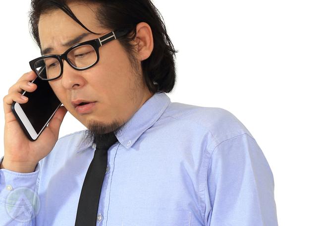sad worried businessman on the phone