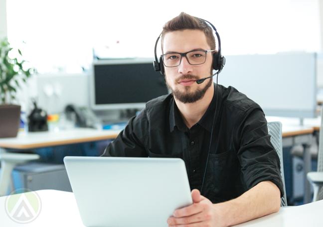 serious call center agent using laptop