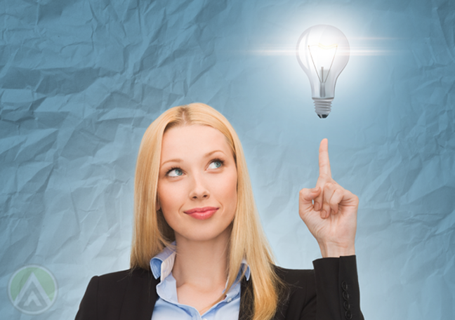 smart business woman with bright idead concept pointing to floating light bulb
