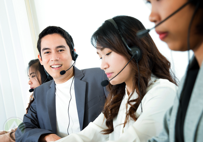 smiling call center agent with customer service team