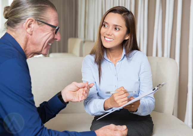 smiling employee interviewing middle aged coworker