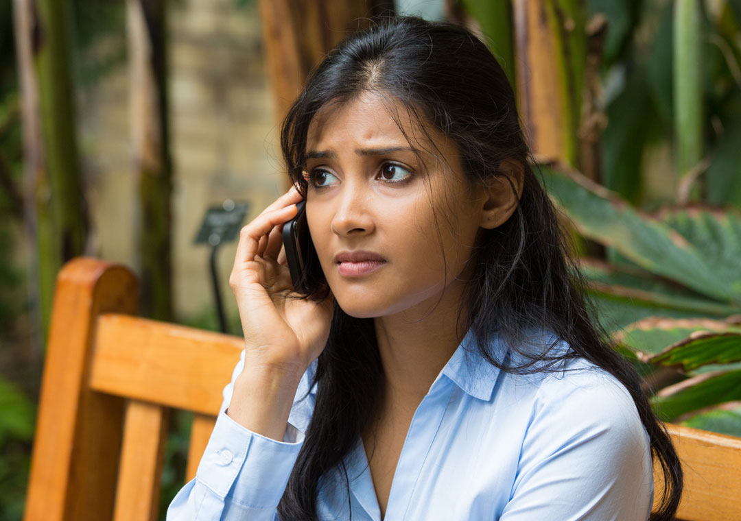 sserious woman speaking to customer service hotline on phone