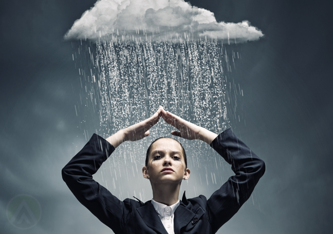 successful business woman shielding self from rain from dark cloud