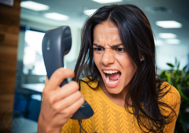 woman scraming at telephone