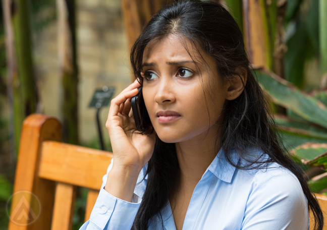 worried woman on the phone