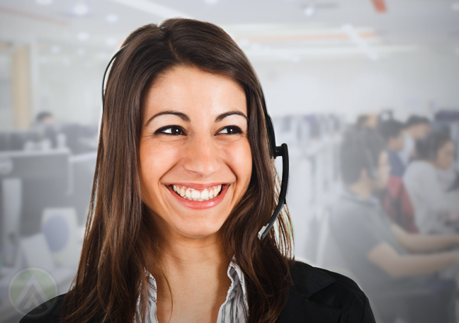 brightly smilng customer support agent in call center