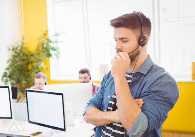 busy call center rep in call in yellow room