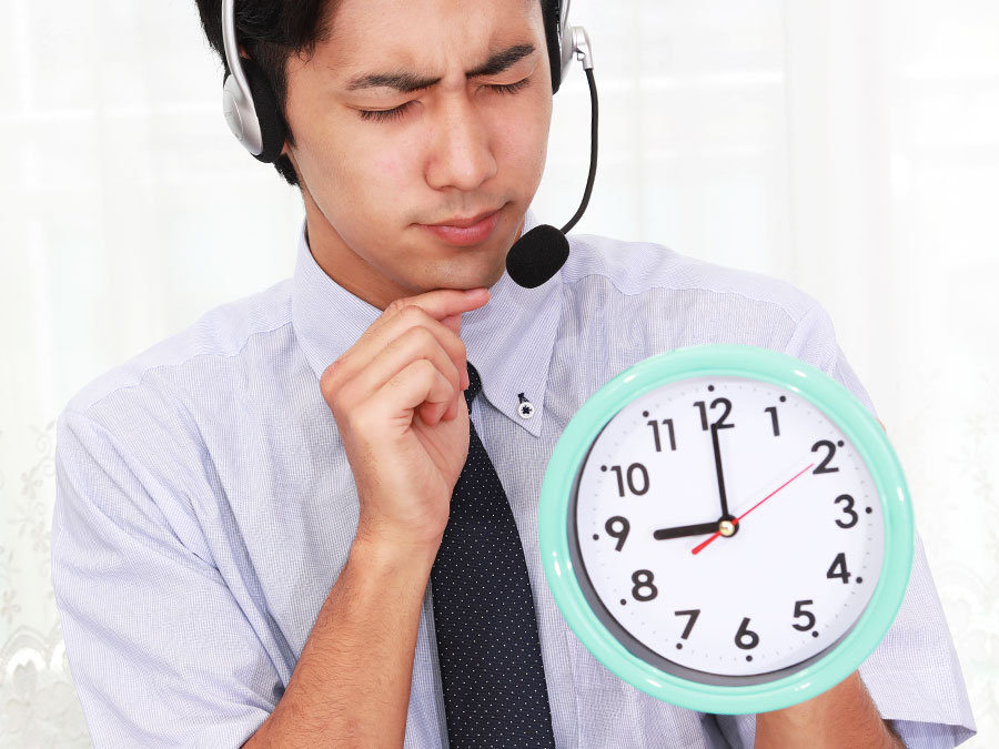 call center agent holding wall clock watching productivity