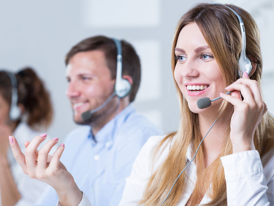 cheerful call center agent with customer care team