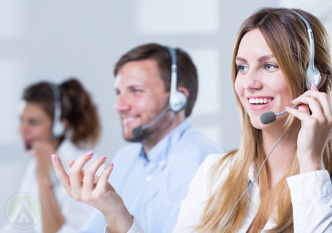 cheerful call center agent with customer service team