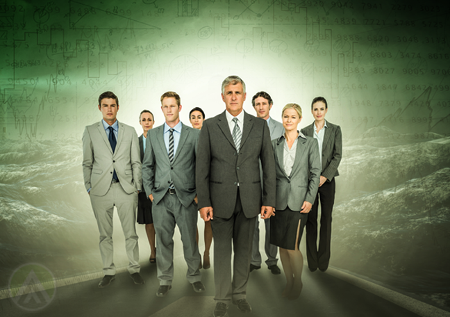 confident business team standing in green mountain landscape