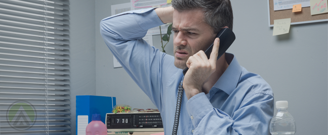 confused businessman scratching his head in office