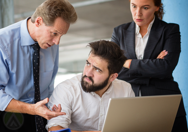 coworkers arguing by laptop