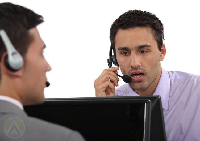 customer service agents in call center speaking on headset