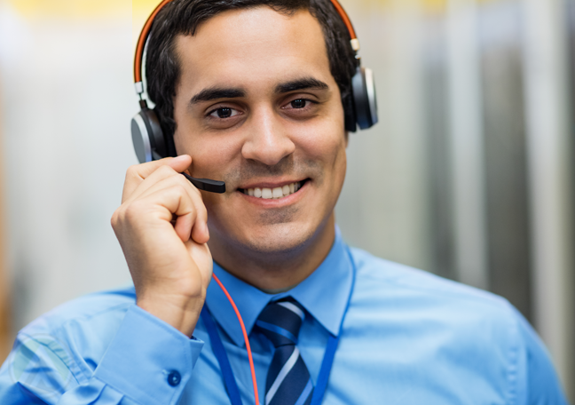 customer support rep in blue answering call on headset