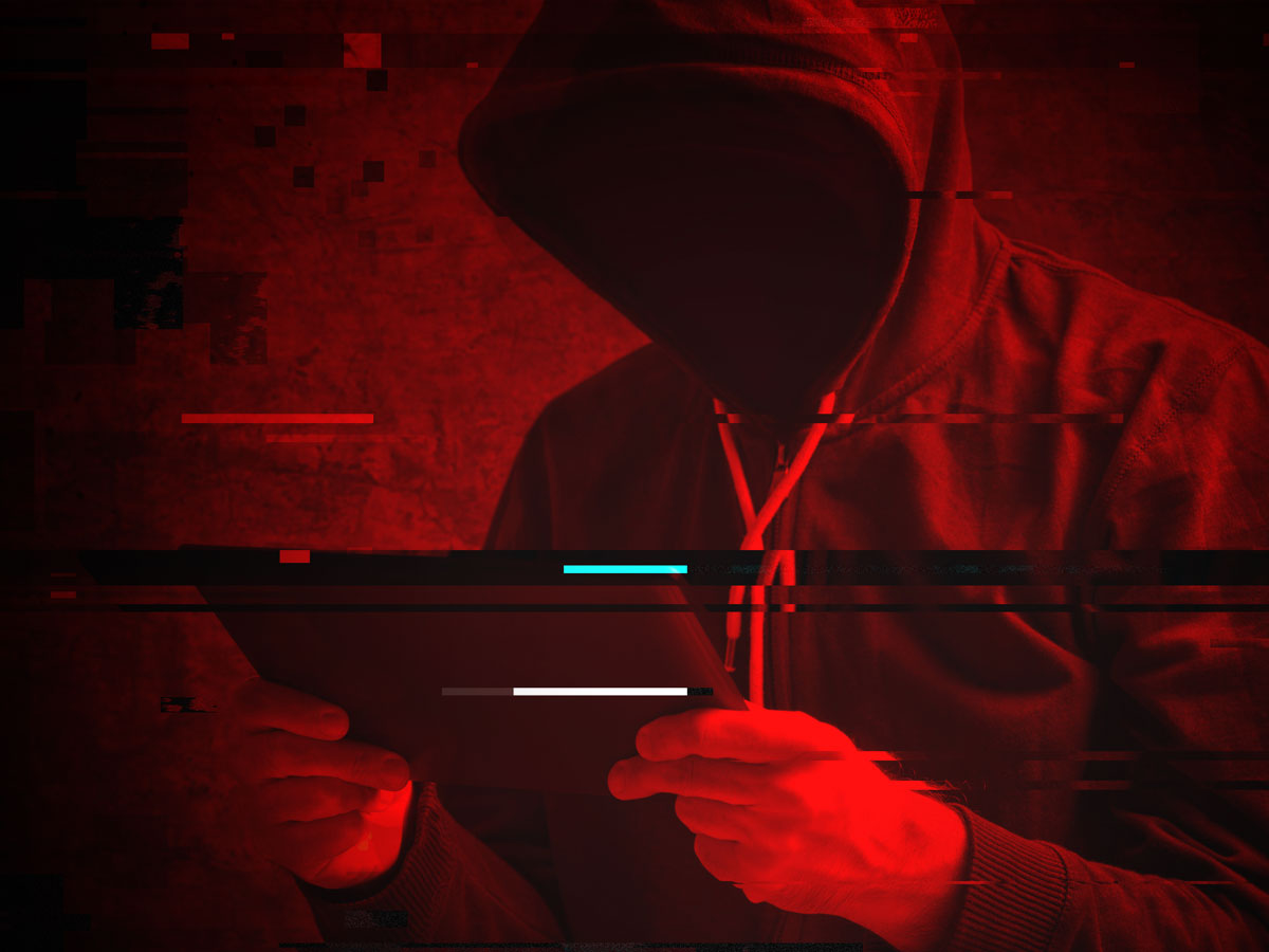 cybercriminal in hoodie hacking ecommerce website