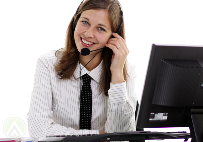delighted customer service rep making call to client