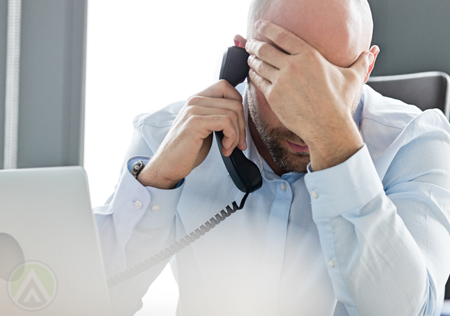 frustrated businessman using phone