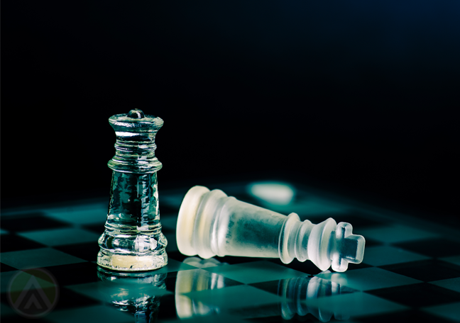 glass chess pieces in dark