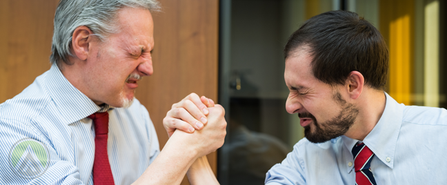 middle aged business executives partners locked in arm wrestling