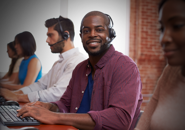 smiling young call center agent surrounded by customer service agents