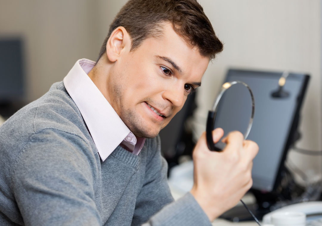 stressed out customer service call center agent holding headphones