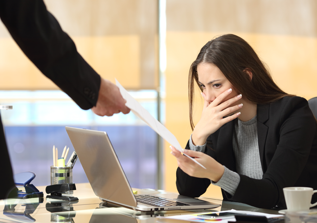 worried business executive receiving paper printed document from coworker