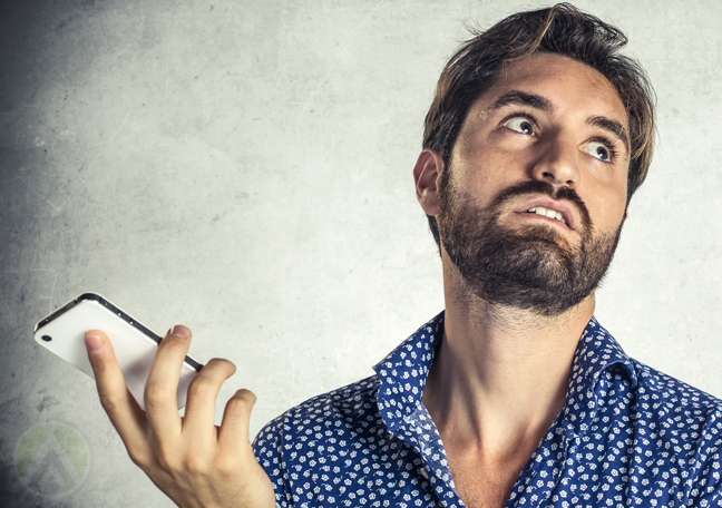 bearded man rolling eyes holding smartphone during phone call