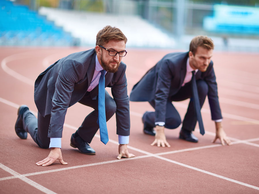 business men rivals in race on running track field