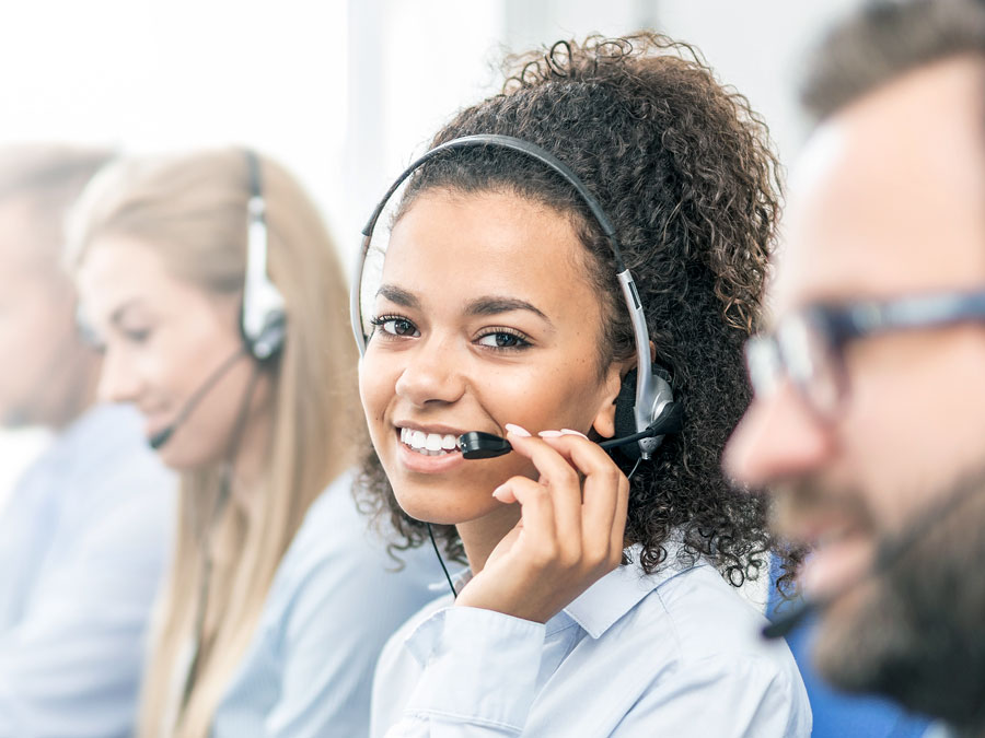 busy customer support agent in call center