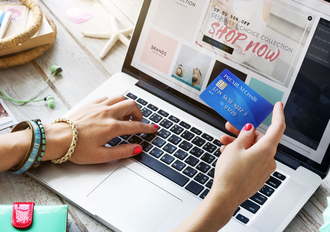 customer care preferences shown as consumer holding credit card on laptop for online shopping