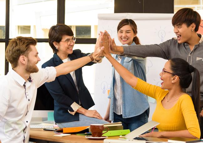 diverse business team high five in employee engagement teamwork