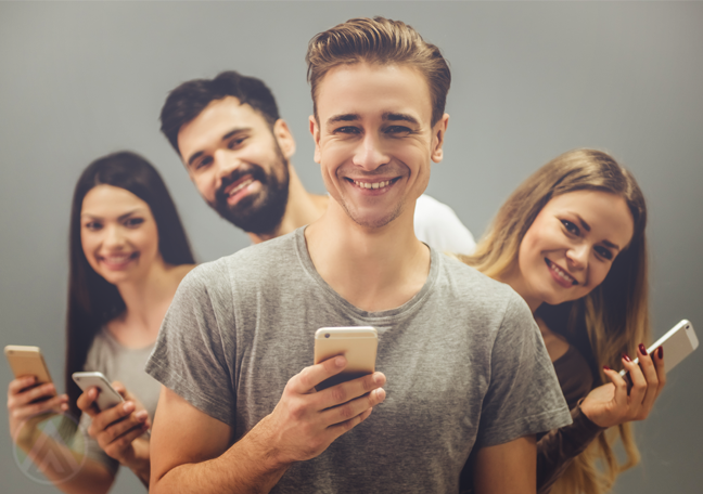 smiling group young people using smartphones