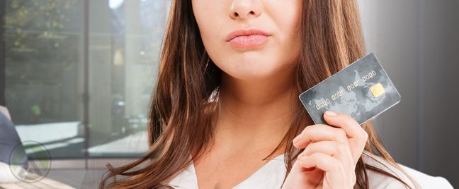 woman thinking hard holding credit card