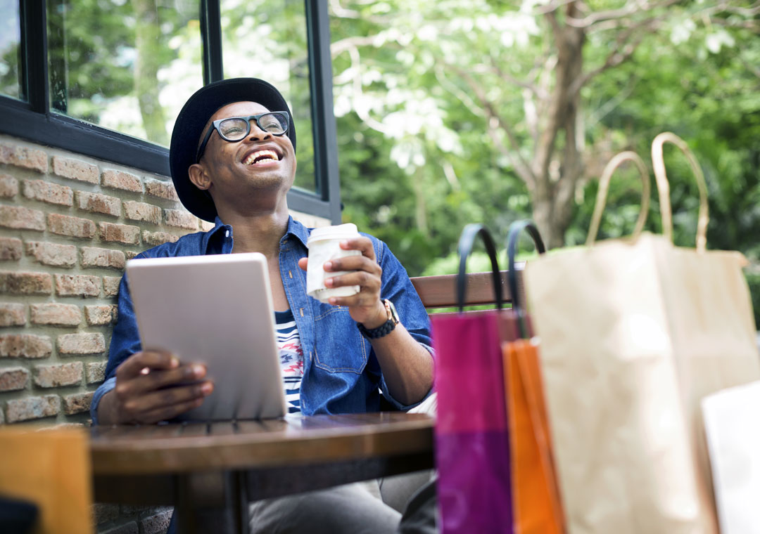 young man with customer care preferences online shopping in coffee shop