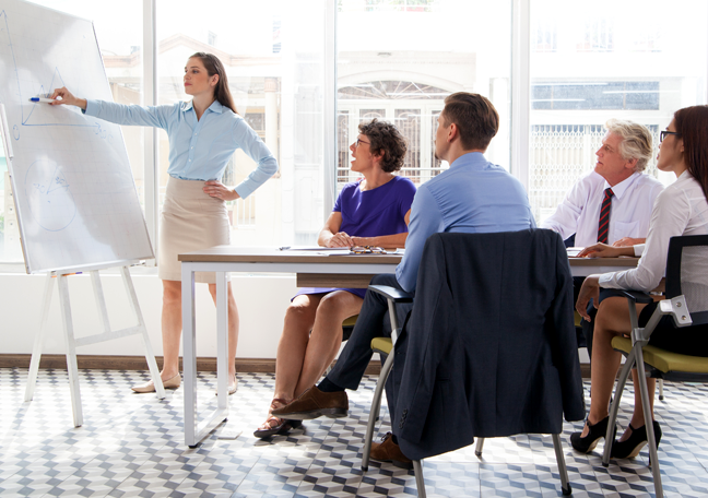 call center team leader writing on white board during office meeting