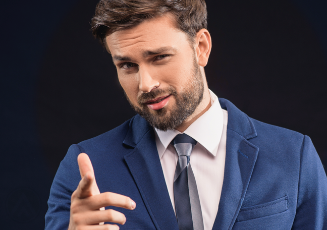 confident office employee in blue suit pointing to reader