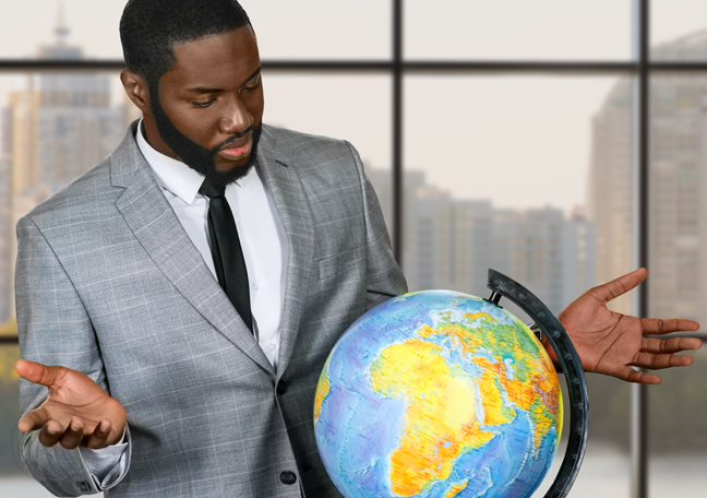 confused businessman looking at globe