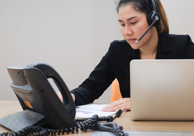 customer service rep in call center using phone unit
