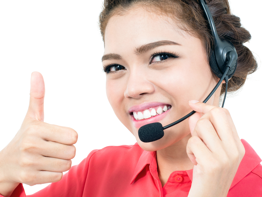 customer support agent in call center giving thumbs up in approval