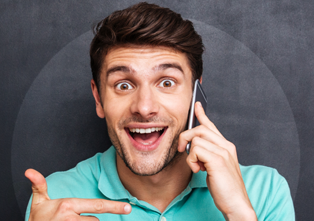 man delighted by customer engagement during phone call