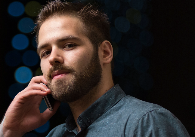 proud arrogant young man making call on smartphone