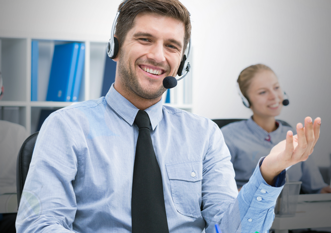 speaking call center rep with hand gestures in a call center