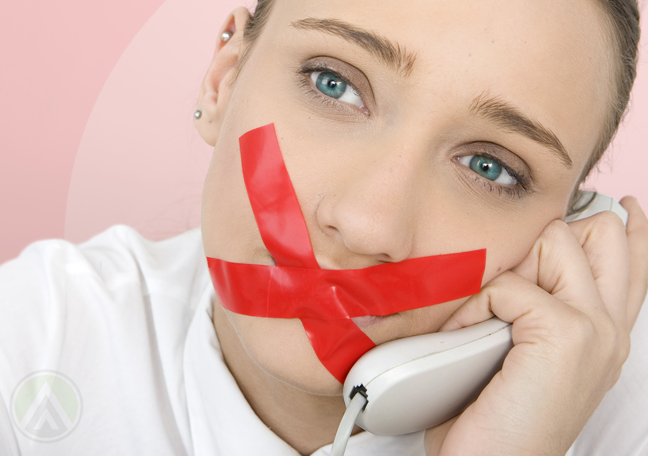 woman with red tape covering mouth using the phone