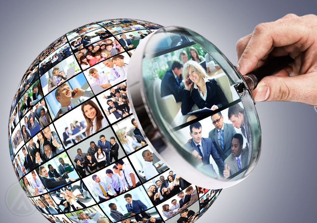 customer service representative holding magnifying lens by globe with photos of business people