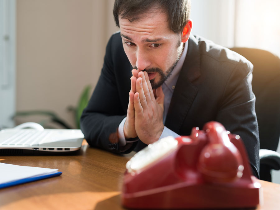 businessman waiting for call begging phone