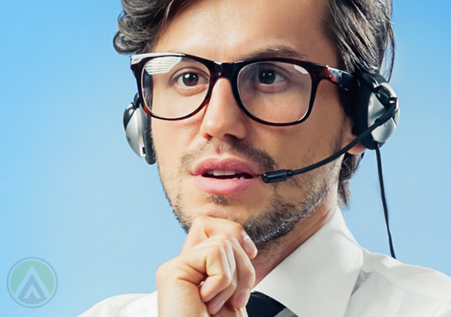 call center rep in glasses thinking deeply